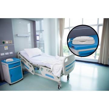 Teléfono monobloque analógico compacto con teclado integrado en el auricular en una habitación de hospital